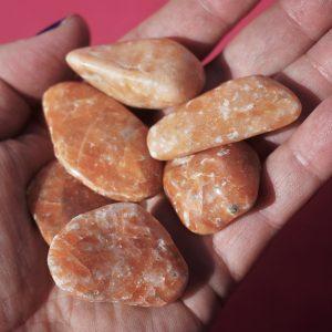 Orange calcite tumbles