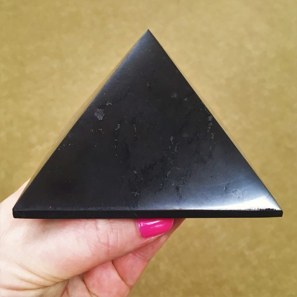 More amazing Large Shungite Pyramids - from a new supplier and Aussie dollar was good so prices dropped a lot. Much flatter polishing style than other shungite pyramids of the past - i.e. more the same finish of obsidian and jaspers you buy as balls, slices and pyramids. Massively popular with those wanting to put protection from Wi-Fi, electronics etc in front of their PC and other electronics. Men love them. Note that with all our crystals you get information cards about the crystals. The photo is a guide as they all look nearly identical to one another. Shungite is a highly concentrated carbon. More than 2 billion years old before organic matter existed. It clears out mental and emotional pollutants so fresh patterns can imprint.