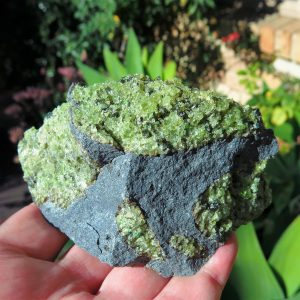 Peridot on basalt specimen
