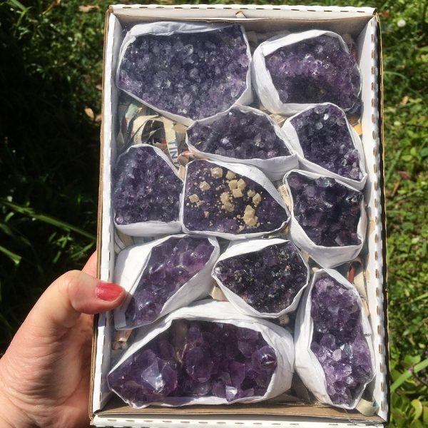 box of Brazilian amethyst clusters
